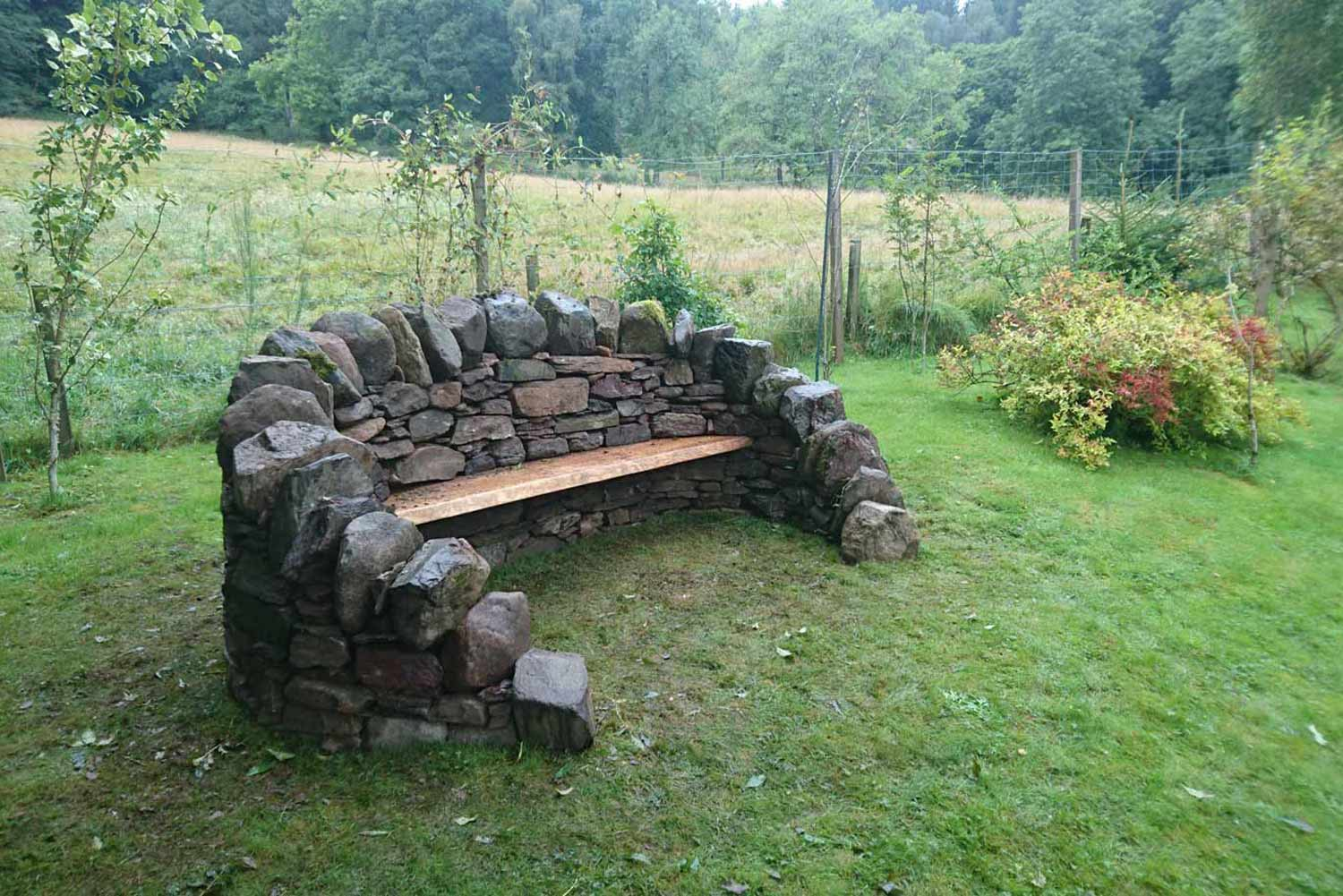 Curved Dry-stone bench with oak seat