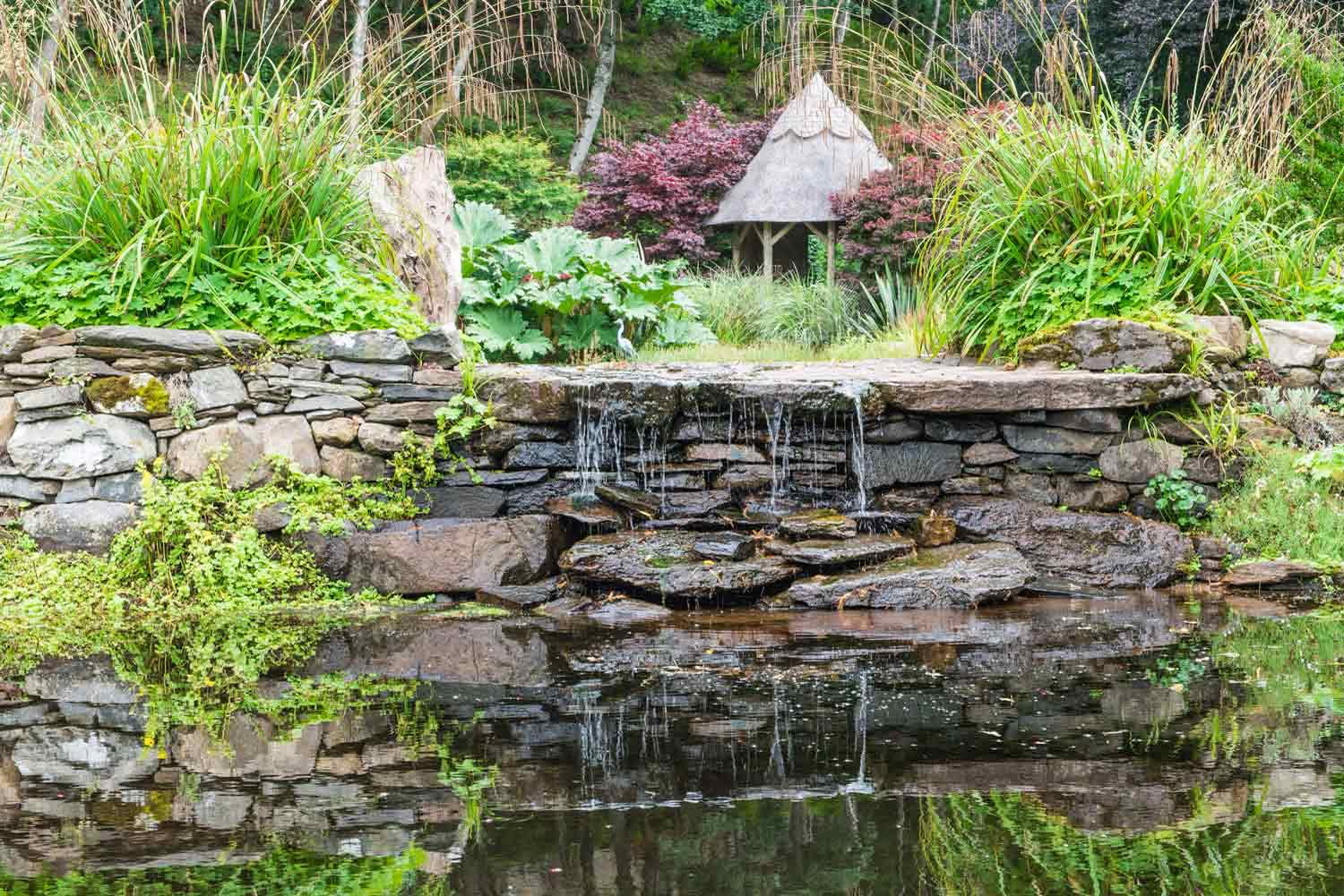 This waterfall feature created from drystone walls blends sympathetically with the landscape bringing a natural, soothing vibe to this beautiful Scottish garden.
