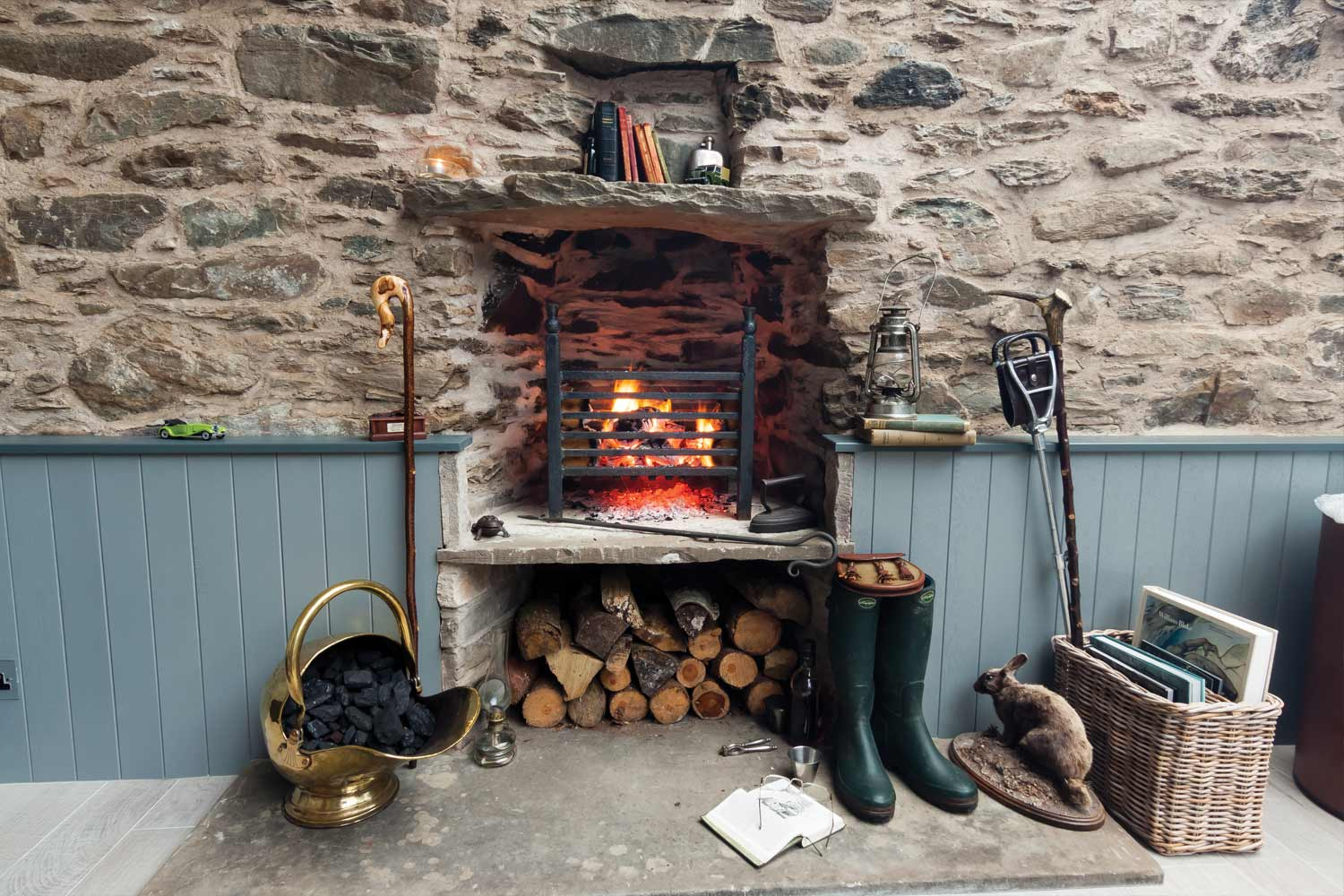 Cottage Fireplace with log store and bookshelf