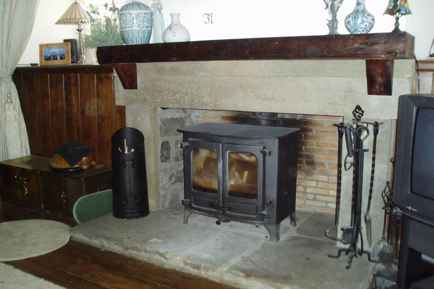 A simple sandstone fireplace to accommodate a large stove