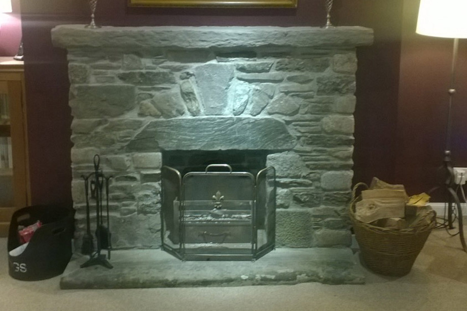 A very popular choice of stone surround for a simple traditional open fire